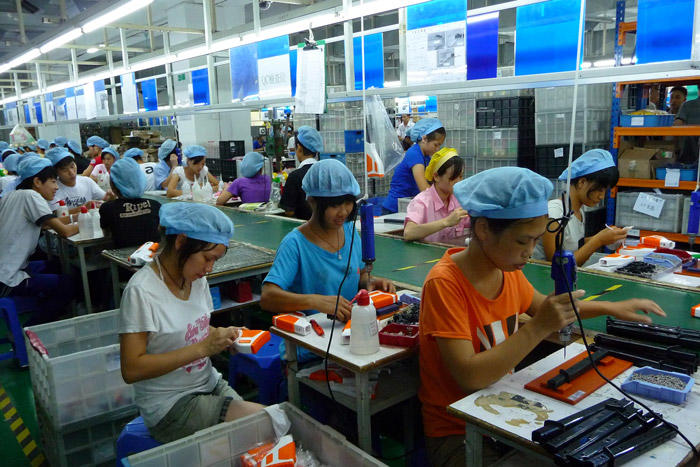 Image of workers in a Chinese Toy Factory