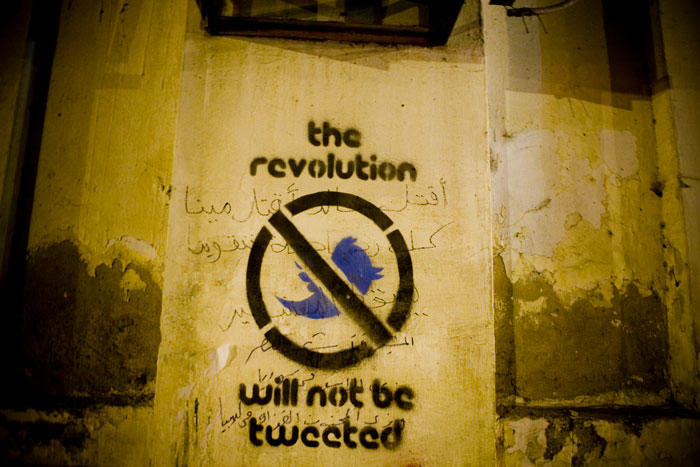 Image of graffiti with the message the revolution will not be tweeted