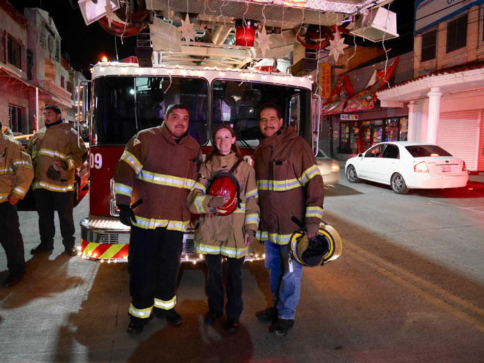 Image of Ieva Jusionyte with two Mexican firefighters