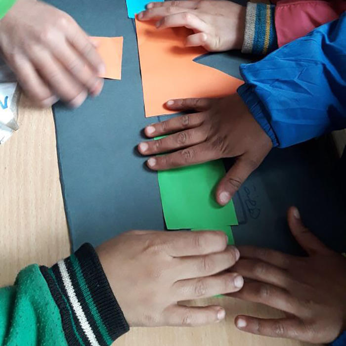 Image of student hands building a map