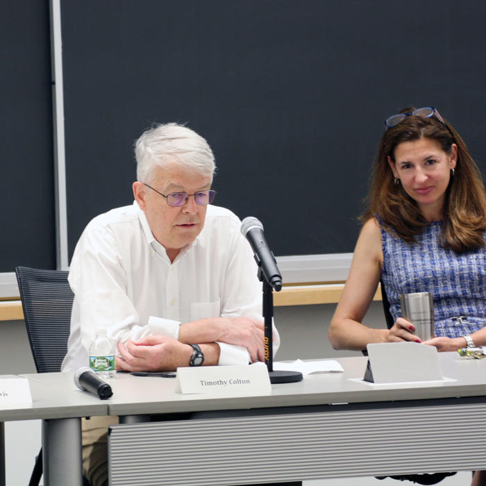 Image of Tim Colton and Melani Cammett at the orientation panel