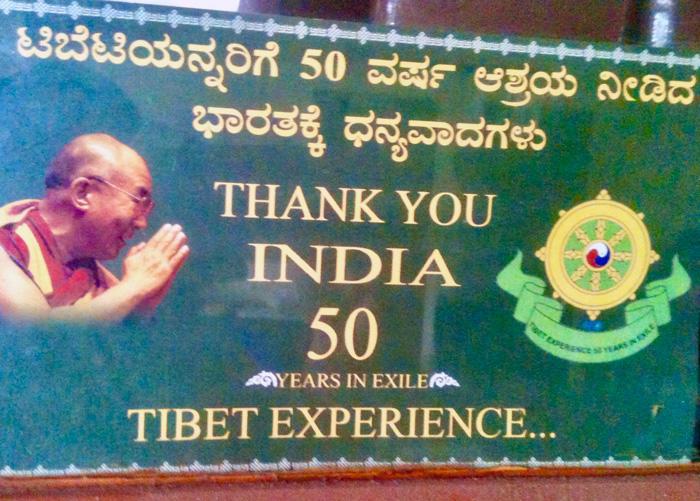 Image of billboard commemorating fifty years of exile in India from the Tibetan settlement at Bylakuppe, Karnataka in southern India