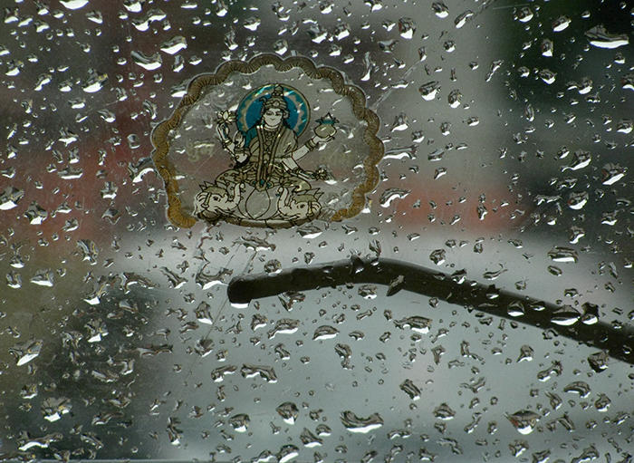 Image of water droplets on a taxi window.