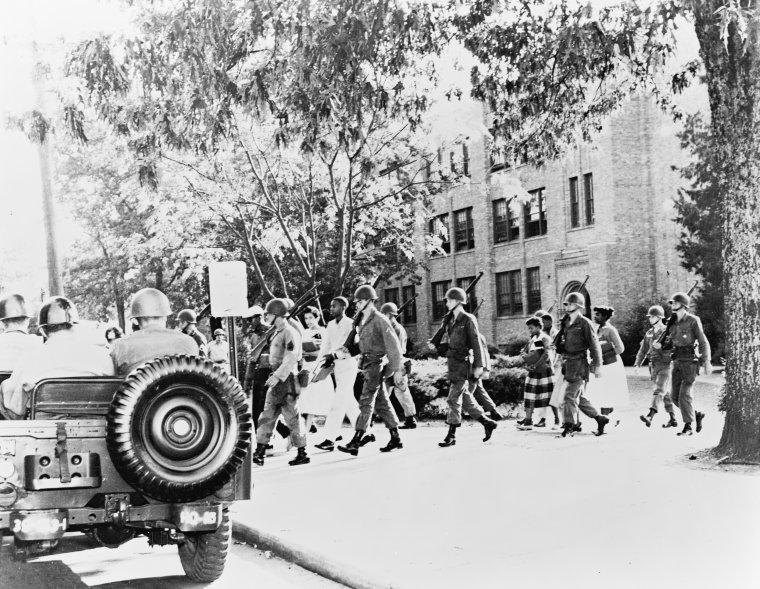 Image of National Guard escorting students