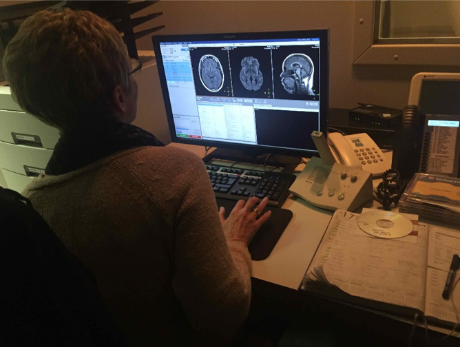 Woman interpreting MRI