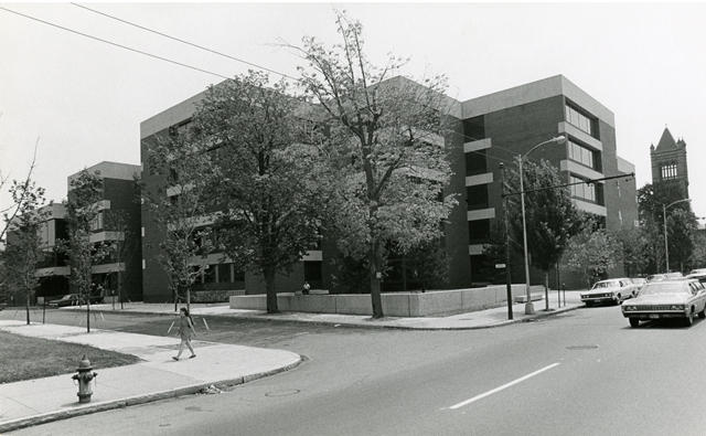 Black and white image of Pound Hall from across Massachusetts Ave.