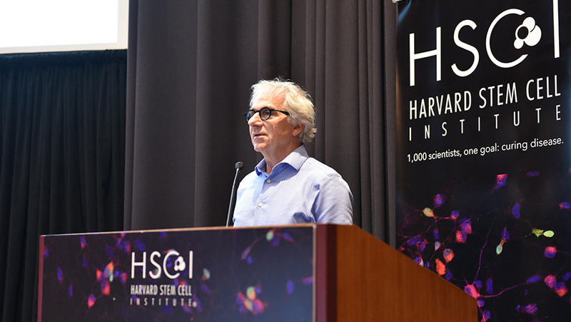 Doug Melton standing at an HSCI podium