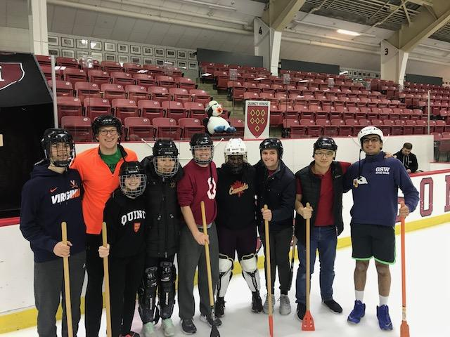 Broom ball team all posing together