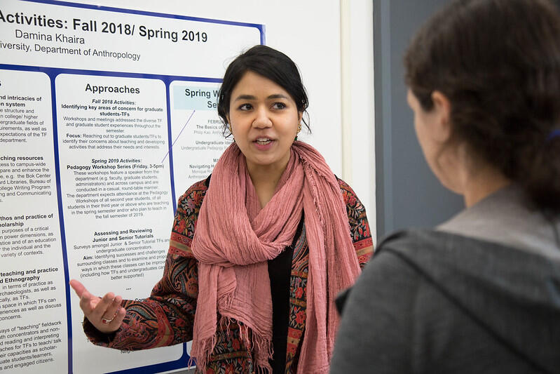 A pedagogy fellow presents a poster during the program's capstone event.