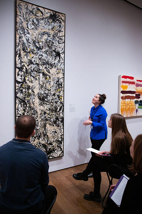 Jen Thum looks up at a 9 foot tall Jackson Pollock painting while facilitating a workshop at the Harvard Art Museums.