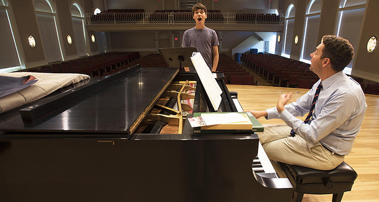 Choir Master Edward Jones works with student in Paine Hall
