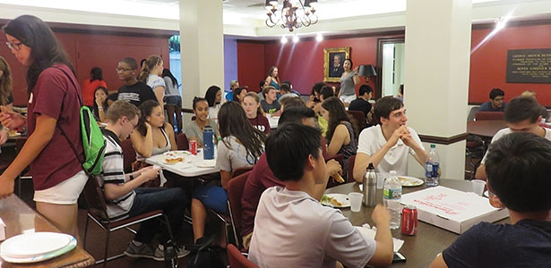 Students from the Harvard Dorm Crew enjoyed a well-deserved dinner break hosted by MemChurch in the Buttrick Room the Friday nig