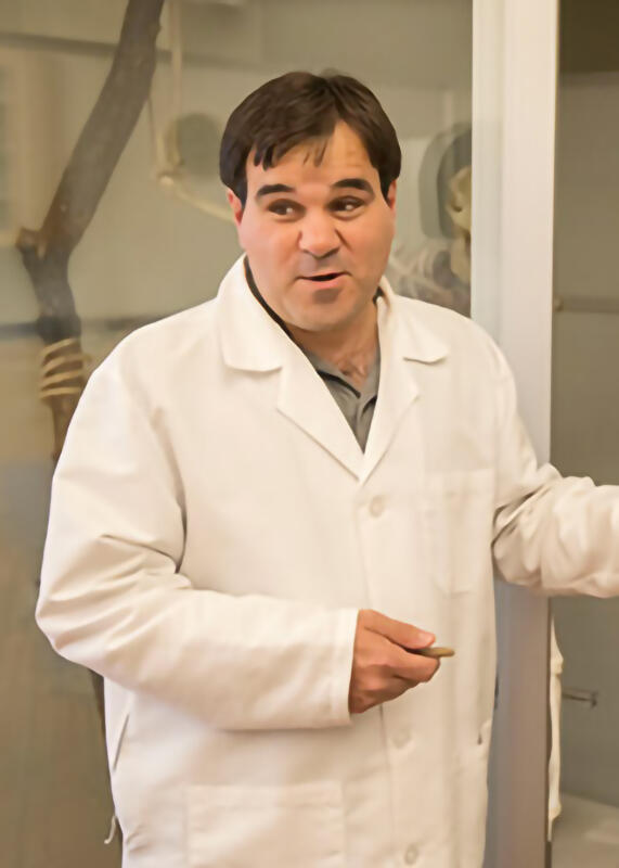 Terence D. Capellini standing next to a human skeleton