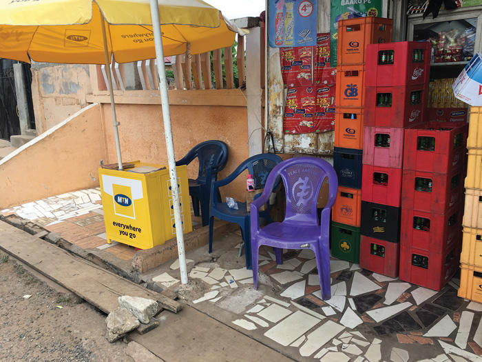 Image of plastic chairs with Adinkra symbol on them