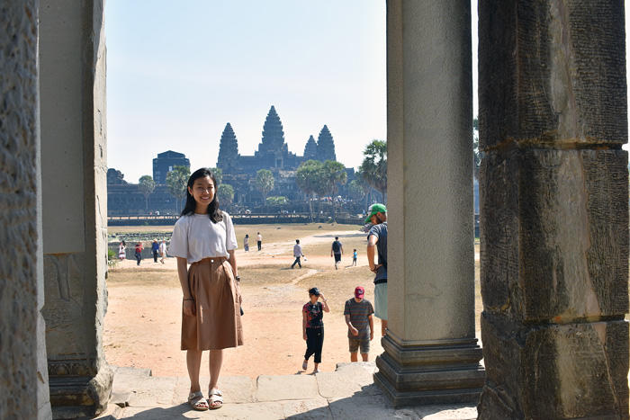 Image of Julie standing at Angkor Wat