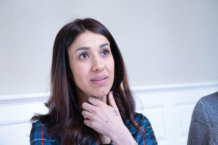 Image of Nadia Murad relaxing in the green room prior to the lecture