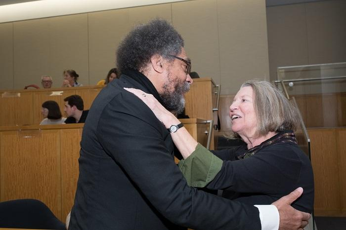 Image of Nancy Fraser hugging Cornel West