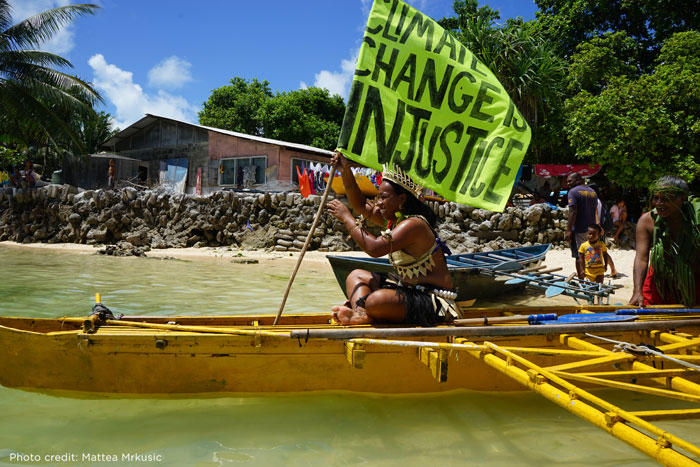 Image of Kiribas climate activist on a boat