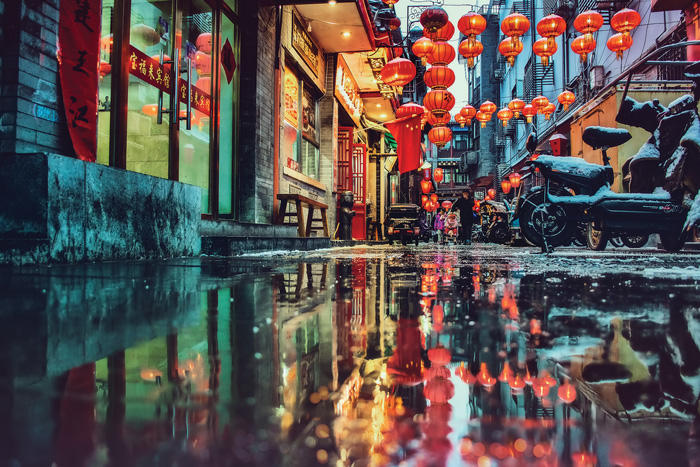 Image of a rainy reflected alleyway in Beijing, China