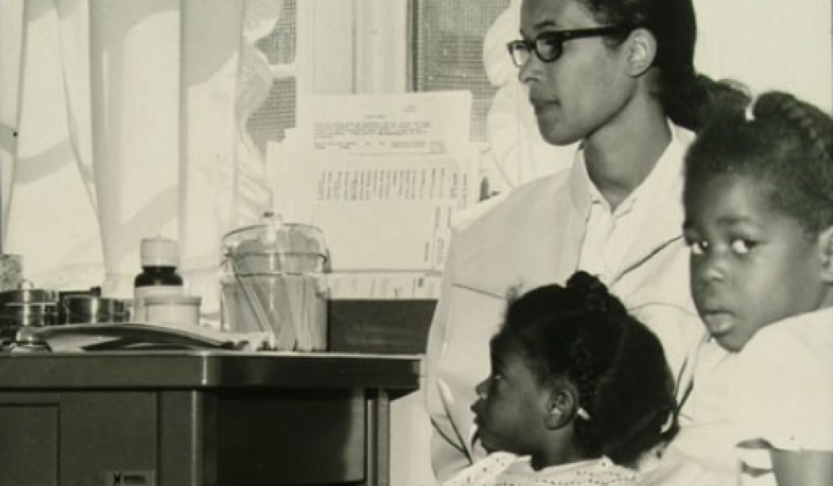 Black mother and two young children at a health center in Boston, 1968