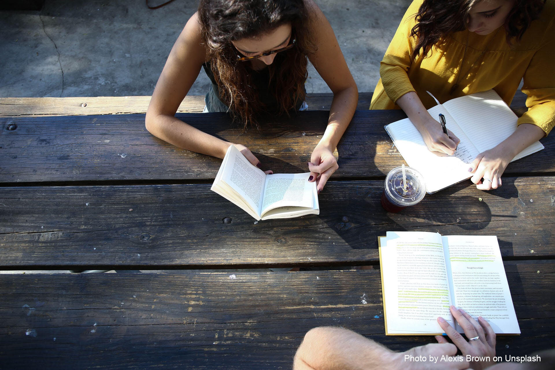 Students studying together on a picnic table