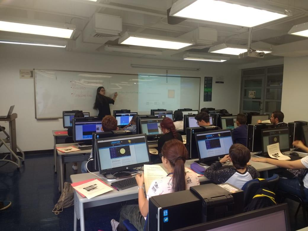 Juliana and the students at the computer lab using the CfA's Exolab platform to find their own exoplanets.