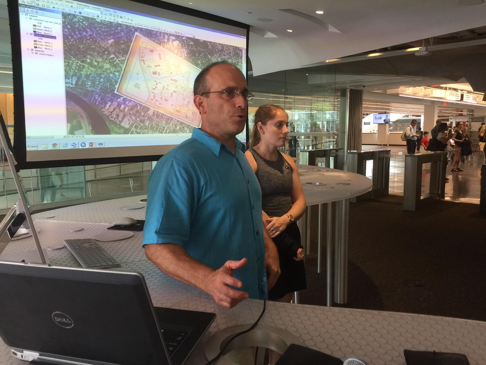 Scott Walker, Digital Cartography Specialist, and Danielle Brown, Geospatial Data Technical Assistant presenting image