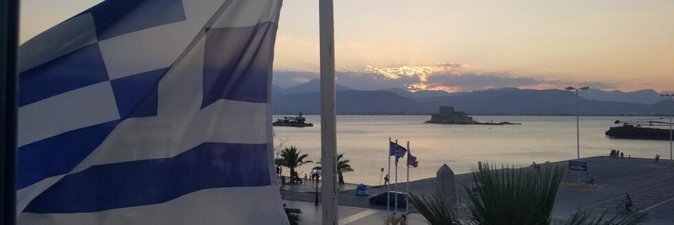 View of the Philhellene Square from the CHS Greece Fellows Room with the Greek flag on the foreground.