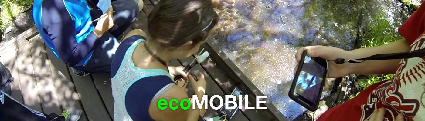 Students using ecoMOBILE on devices in nature.