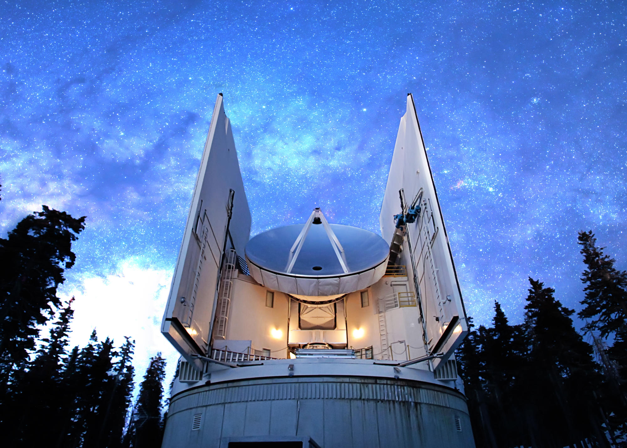 The Submillimeter Telescope under the night sky.