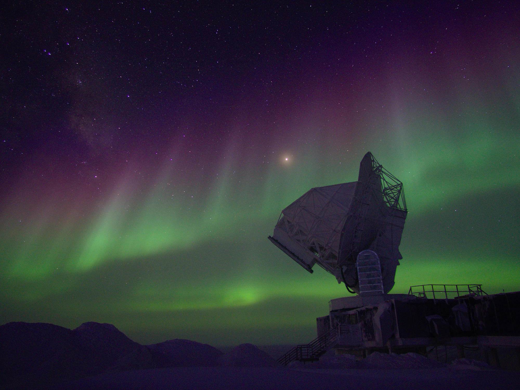The South Pole Telescope observing under polar lights.