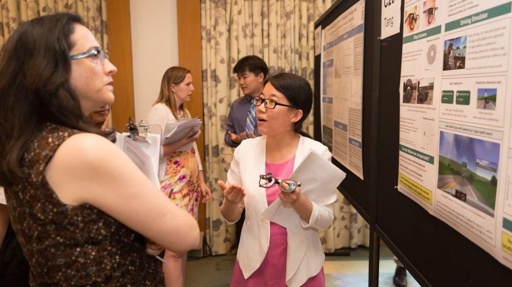 trainees present at AMAR poster contest
