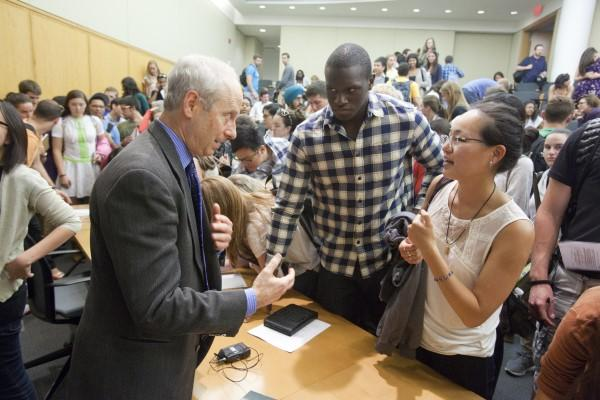Photo of Michael Sandel talking with students