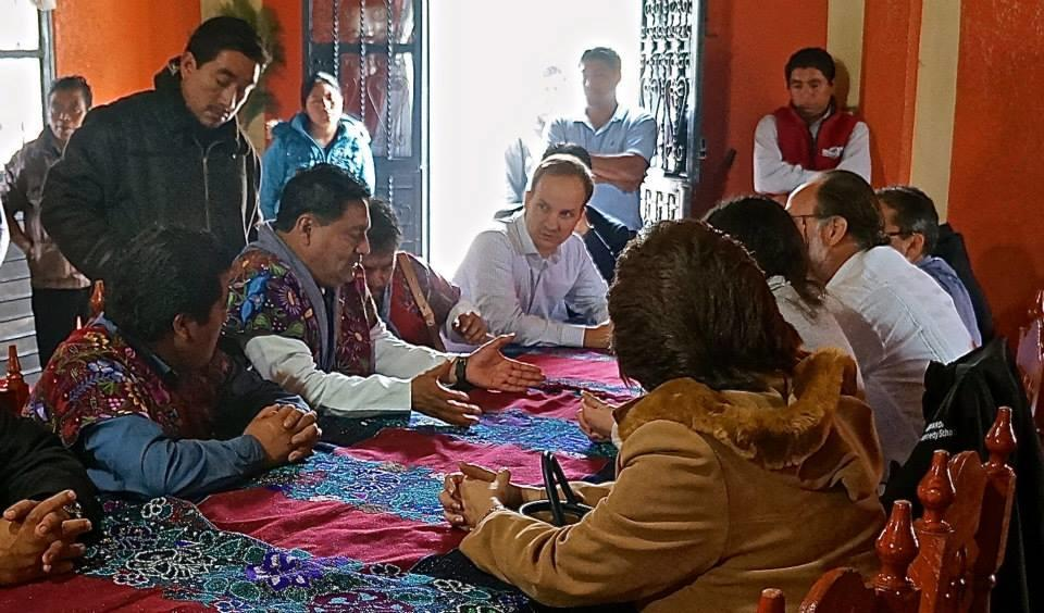 growth lab team members at table with locals in Chiapas, Mexico