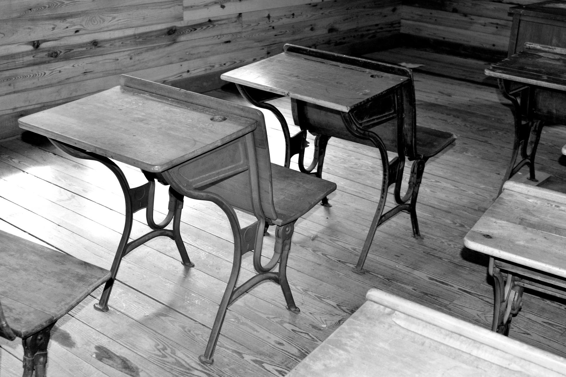 Image of classroom with old desks