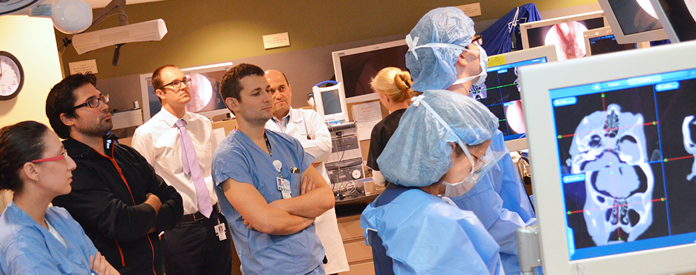 Residents observing in the surgical training lab
