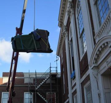 Steinway concert grand being craned into Paine Hall