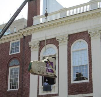 Steinway concert grand being craned out of Paine Hall