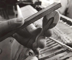 Grand piano hammer being filed with sandpaper paddle