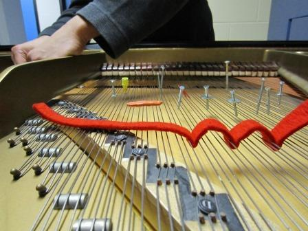 example of preparing a piano with screws, washers, felt, and blu-tack
