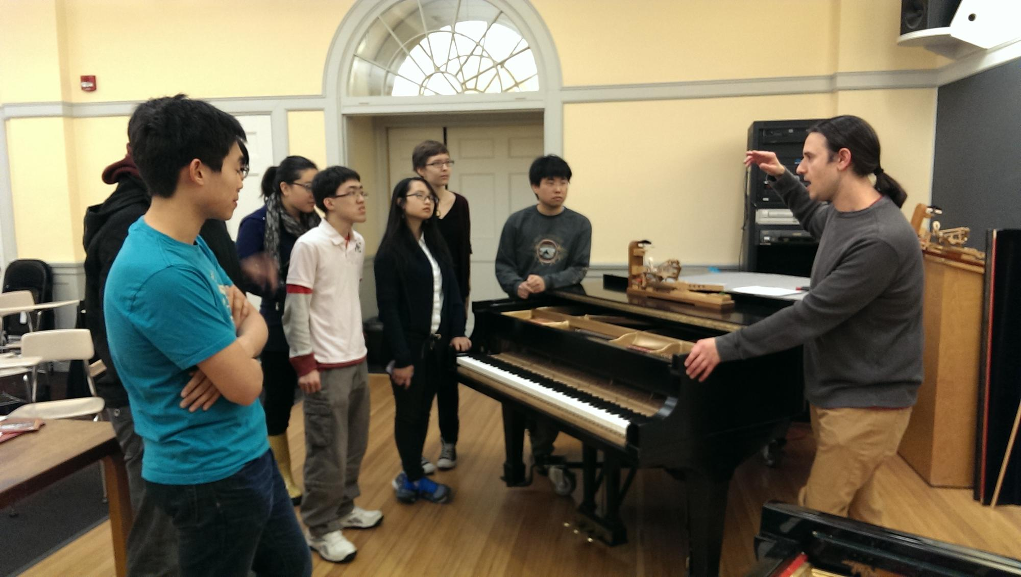 PTS staff member Richard Gruenler giving a workshop on piano technology to the Harvard College Piano Society