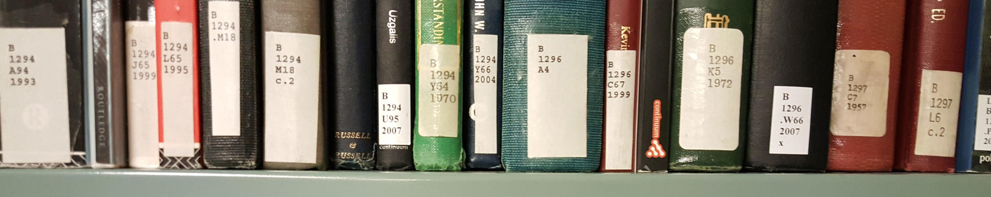 library book spines with call number stickers