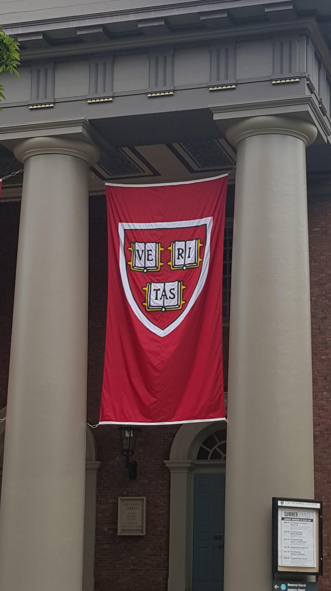 Veritas Banner hanging outside Memorial Hall