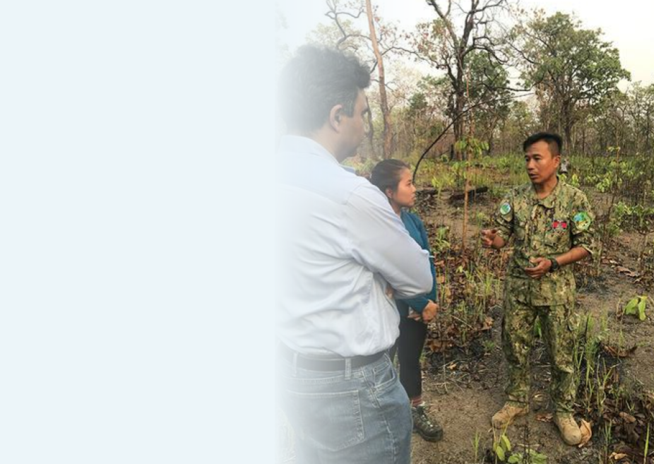 Professor Tambe speaking to a forest guard