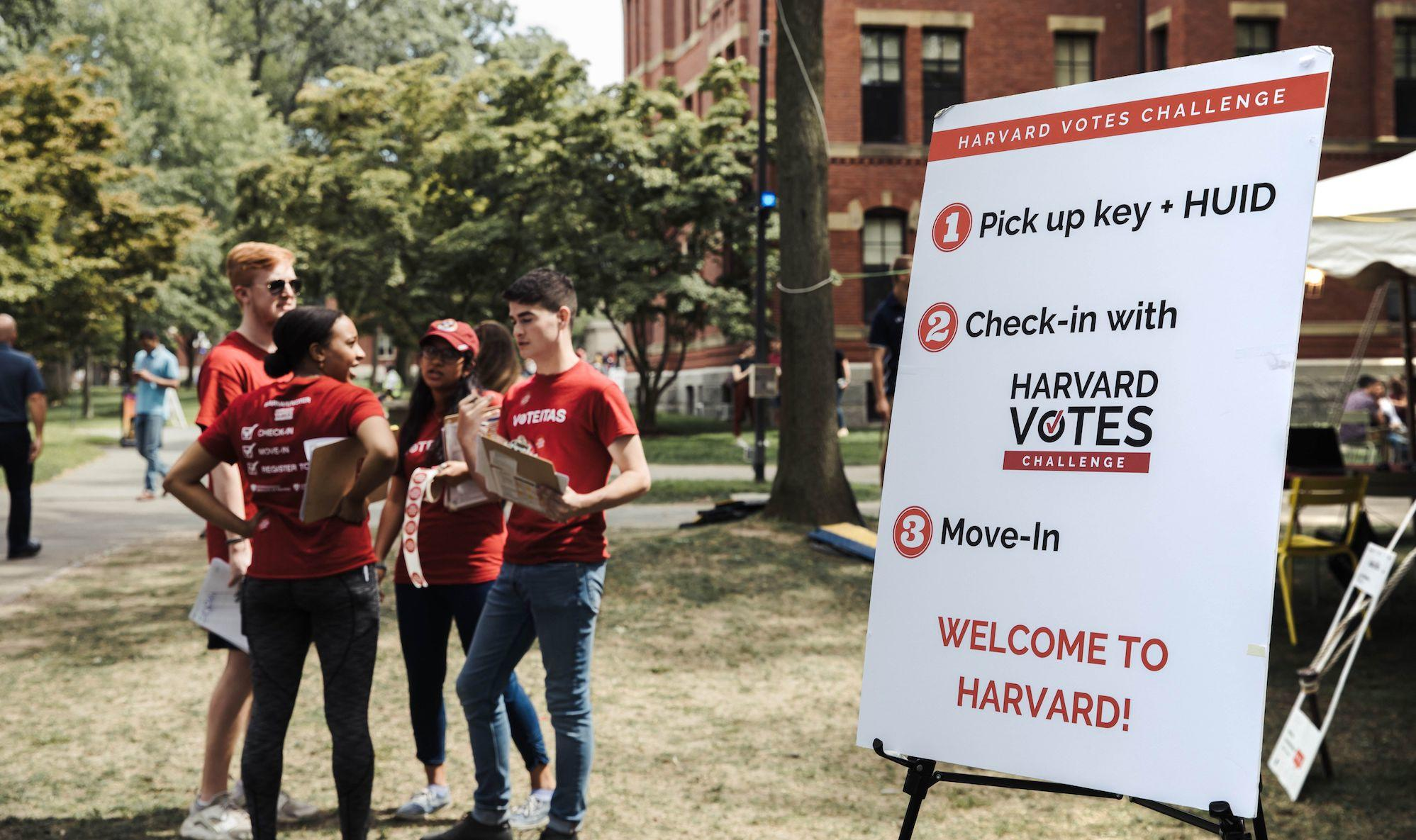 Sign in Harvard Yard directs students to register to vote