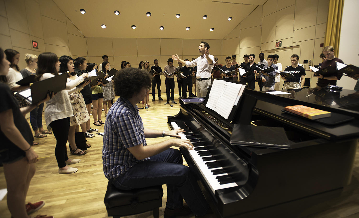 Choirmaster Edward Jones rehearses with University Choir at Paine Hall