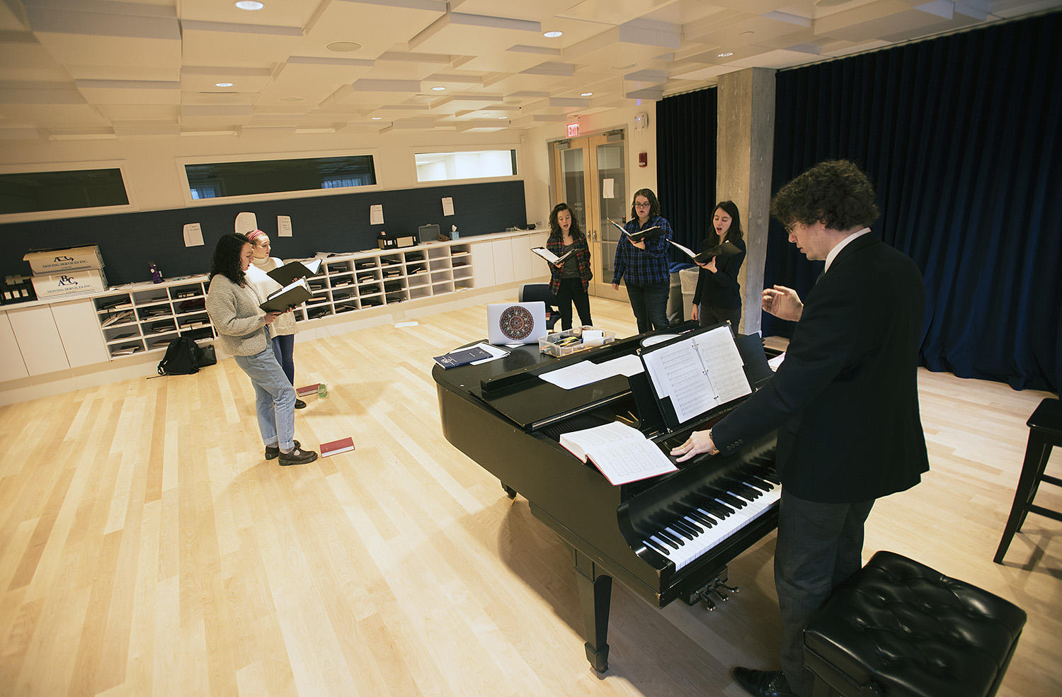 Members of Harvard University Choir rehearse in new choir room