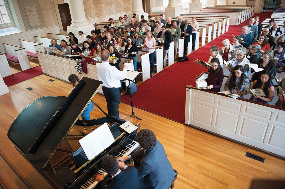 Dr. Murray Forbes Somerville leads returning UChoir alum in song