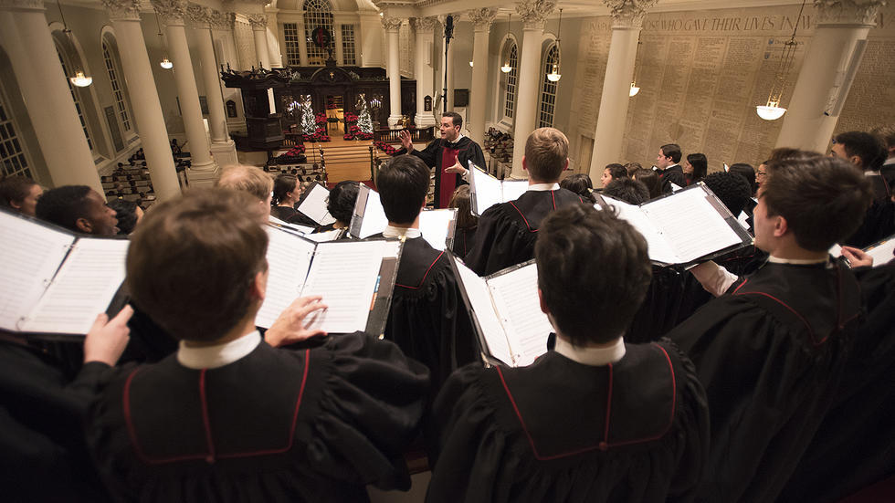 Choirmaster Edward Elwyn Jones conducts the University Choir during the 108th Annual Christmas Service.