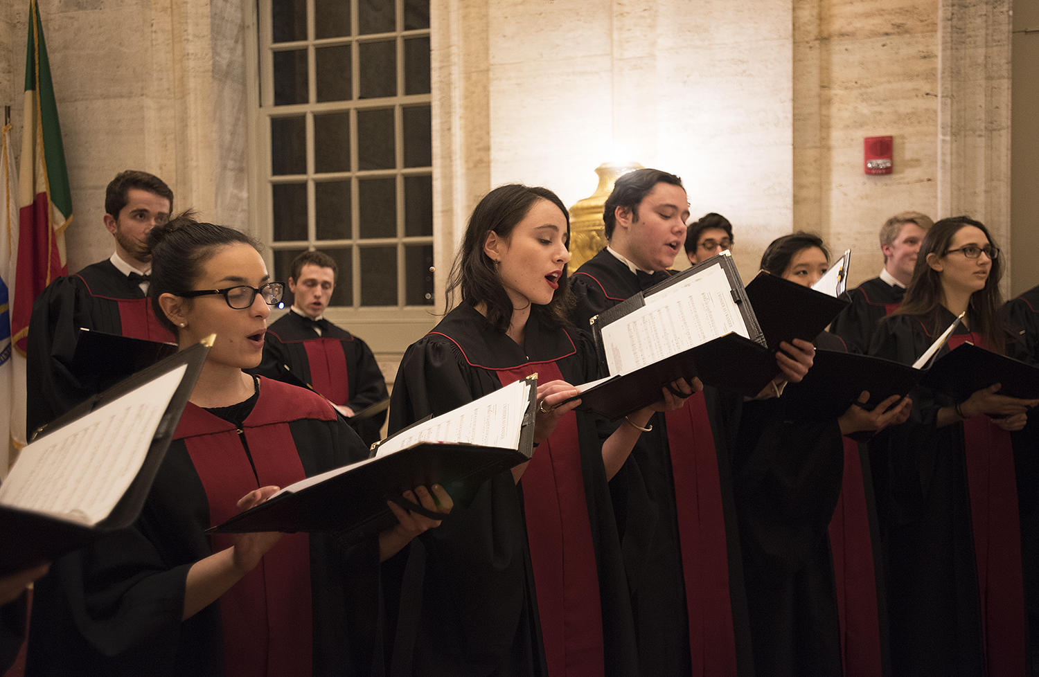 Cara Jacobson '18 (second from the left), a coral fellow and choir secretary, sings in the Memorial room of Memorial Church.